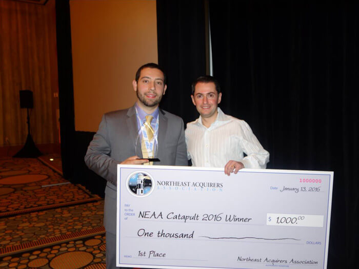 Dimitri Akhrin and Jason Weinberger receiving the first place award in the Catapult competition at the NEAA 2016