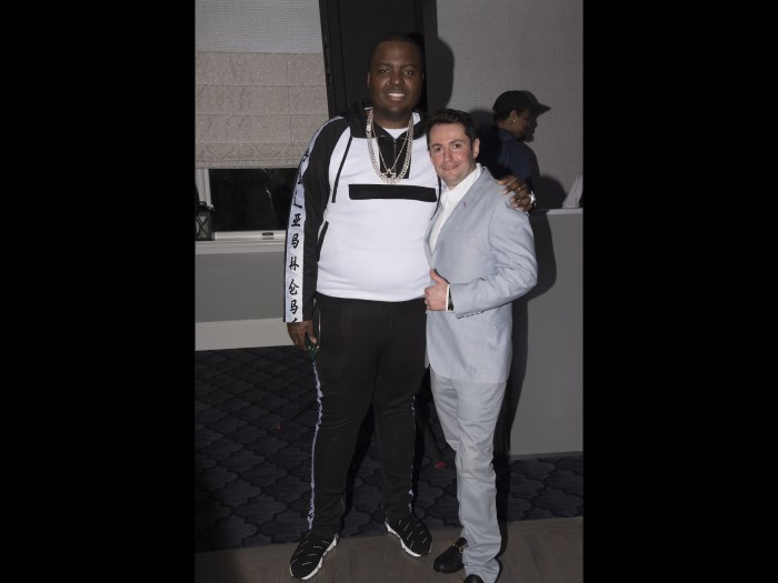 Sean Kingston, musician, with Dimitri Akhrin at an event.